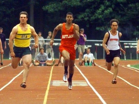 Rutland's Eric Groce, center, ran a 10.82 in the 100-meter