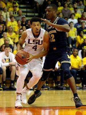 Michigan guard Muhammad-Ali Abdur-Rahkman (12) guards LSU guard Skylar Mays (4) as he heads towards the basket during the first half in the Maui Jim Maui Invitational on Monday, Nov. 20, 2017, in Lahaina, Hawaii.