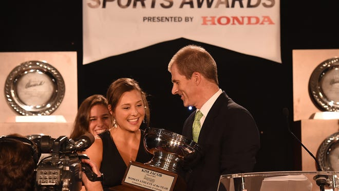 Alabama gymnast Kim Jacob became the Crimson Tide's first Honda Cup recipient as she accepts the award from Erik Weden, manager of corporate community relations at Honda.