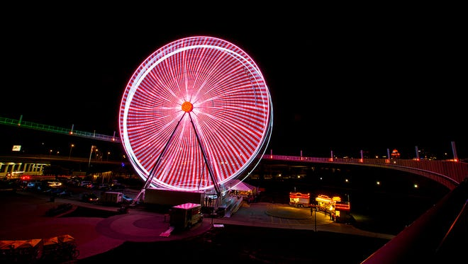 The SkyStar Observation Wheel dazzles with an LED light show at the Big Four Bridge on Friday, March 30, 2018.