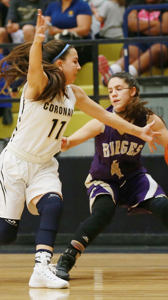 Burges' Kayla Galindo, right, avoids a steal attempt by Coronado's Laura Milliorn during the first quarter Tuesday.