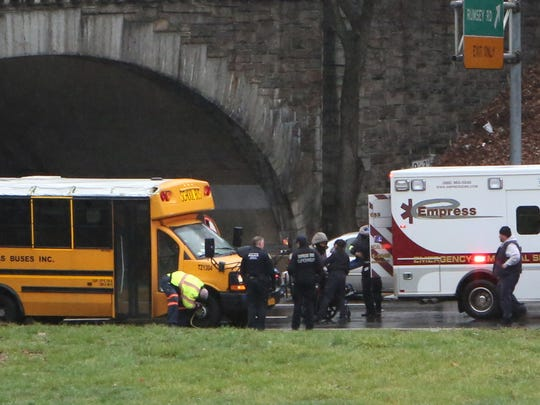 Westchester County police, Empress ambulance personnel and Yonkers police respond after a mini school bus got wedged under the Yonkers Avenue overpass on the Saw Mill River Parkway in Yonkers on April 6, 2017.