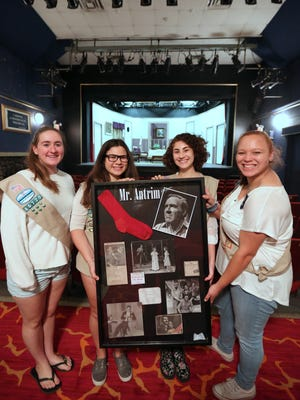 Girl Scouts from Troop 40720 in Suffern, Devon Keeley, left, Paige Danzig,  Danielle Manos and Taylor Wald, all 14,  with one of the 14 shadowboxes they made to display memorabilia of the Antrim Playhouse in Ramapo Sept. 21, 2015.