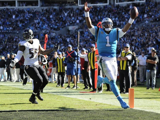 Cam Newton scored a rushing touchdown and threw two others among his 219 passing yards as the Panthers decimated the Ravens' top-ranked defense. The Panthers have won nine consecutive home games.