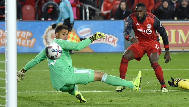 Jozy Altidore  scores against Columbus Crew goalkeeper Zack Steffen during the second half of Toronto FC's 1-0 win.