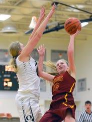 Galesburg-Augusta's Samantha Verburg drives the basket