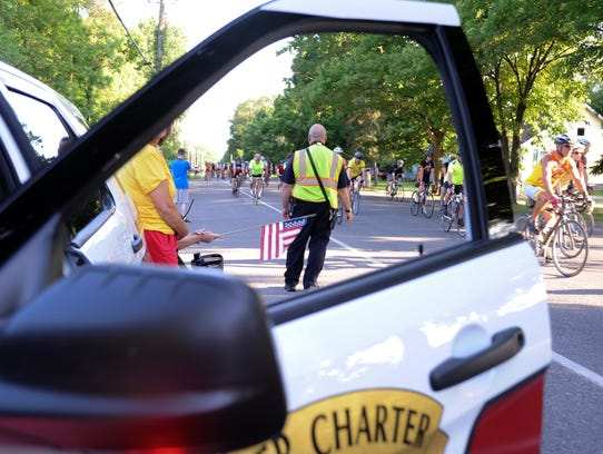 A Cooper Township firefighter watches on as riders