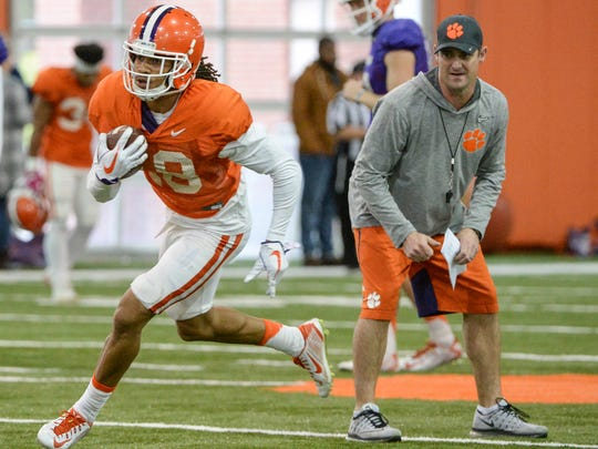 Clemson wide receiver T.J. Chase (18) runs by Clemson