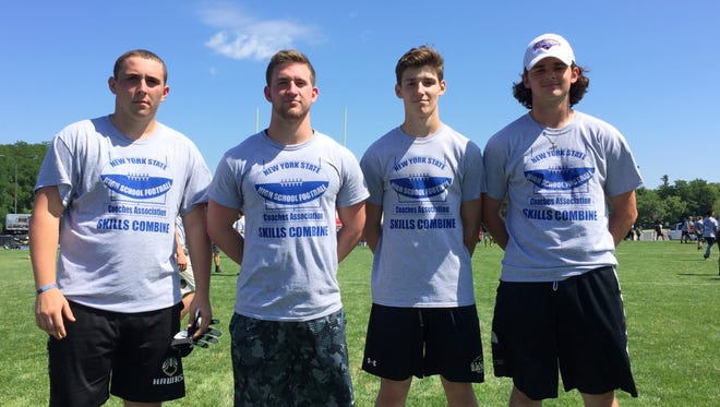 Corning players, from left, Mike DiNardo, David Rowe, Joey Ott and Blake VanWoert at Monday's New York State High School Football Coaches Association Elite Showcase at Ithaca College. Not pictured: Corning's Kyle Jankowski.