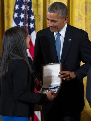 Laurie Yasui, accepts the Presidential Medal of Freedom from President Barack Obama on behalf of her father Minoru Yasui, who fought against United States citizens of Japanese decent being put in internment camps during World War II, during a ceremony in the East Room of the White House, on Tuesday, Nov. 24, 2015, in Washington.  (AP Photo/Evan Vucci)