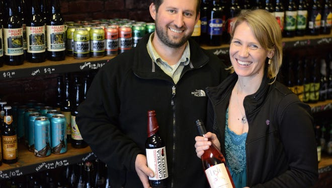 Owners Justin and Shannon Klopfenstein are photographed at Barrel & Keg bottle shop. The shop features a variety of fine wines and craft beers.