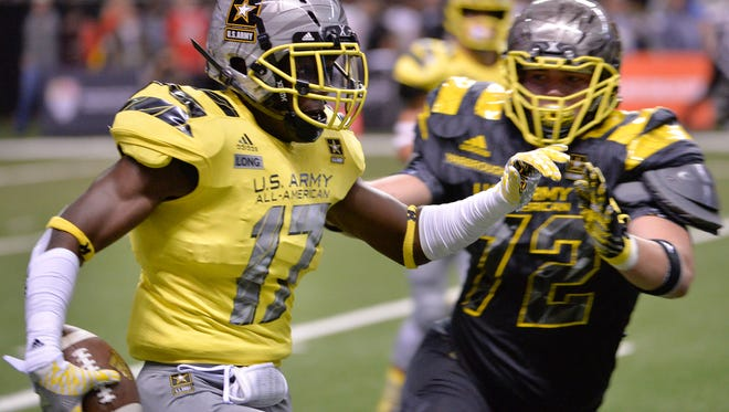 West defensive back David Long (17) evades East offensive lineman Clark Yarbrough after making an interception during the first half of the Army All American Bowl high school football game, Saturday, Jan. 9, 2016, in San Antonio. (AP Photo/Darren Abate)