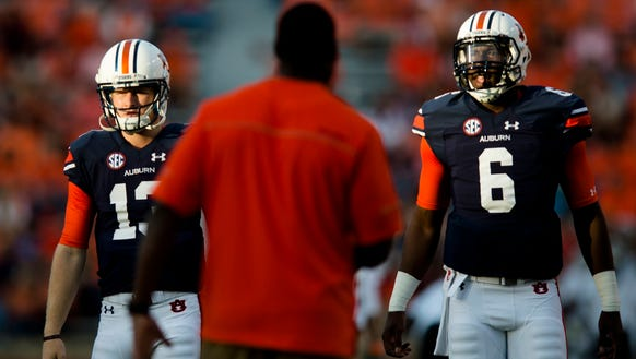 Auburn quarterback Sean White (13) and Auburn quarterback
