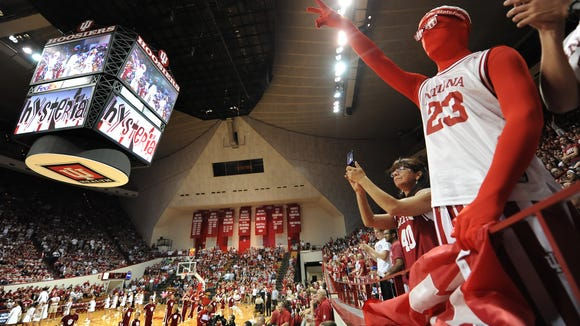 Indiana University fan Austin Frazier shows his support with the cheerleaders while waiting for the hysteria to begin in Assembly Hall during Hoosier Hysteria on Friday, October 4, 2013. Matt Detrich / The Star