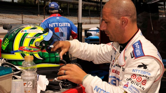 Indianapolis 500 winner Tony Kanaan prepares for his first practice in the Ganassi Racing Daytona Prototype at the Indianapolis Motor Speedway on July, 25, 2013.
