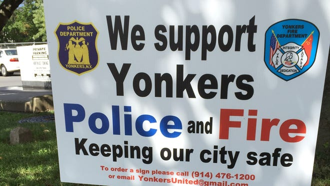 A lawn sign distributed by the Yonkers firefighter union on Central Park Avenue.