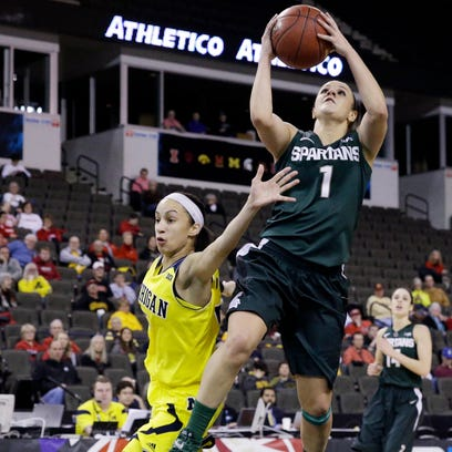 Michigan State guard Tori Jankoska, right, drives to the basket against Michigan guard Shannon Smith during the first half of their Big Ten tournament game in Hoffman Estates, Ill. MSU won, 69-49, improving to 16-14 on the season and setting up a quarterfinal matchup with top seed Maryland.