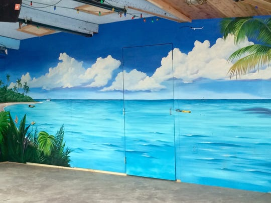 Pam Mason and Kathy Denk painted murals in Seacrets Bar and Restaurant.