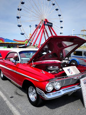 A '61 Chevy Impala   sits on display at the Cruisin' Ocean City car show.