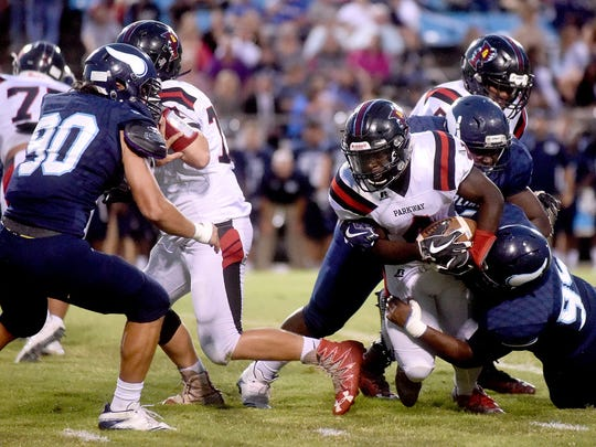 Parkway's EJ Williams stretches for yardage against