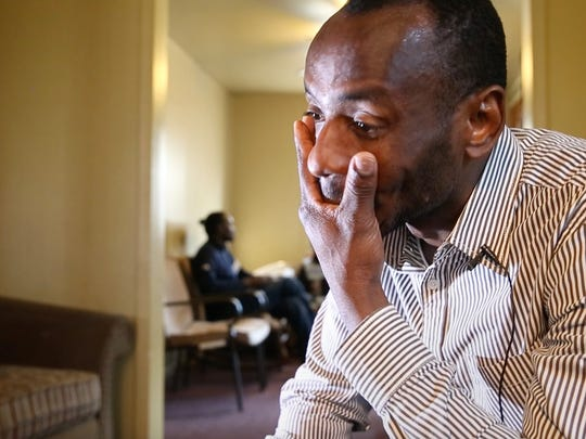 Sudanese refugee Al Ghali Yahia collects his emotions while talking about his wife, Zekrayat Yahia, while in the living room of his home in Rochester on Wednesday, Feb. 14, 2018.