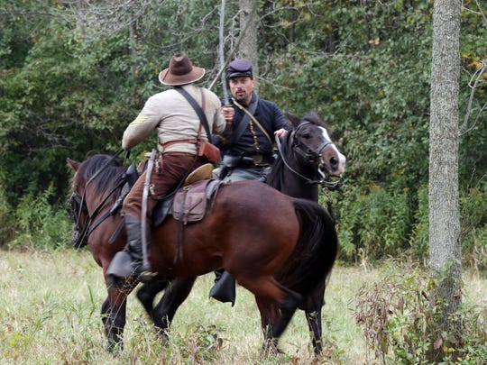 Re-enactors portray a battlefield skirmish on Sept. 26, 2015, during the Civil War Weekend at the Wade House Historic Site in Greenbush.