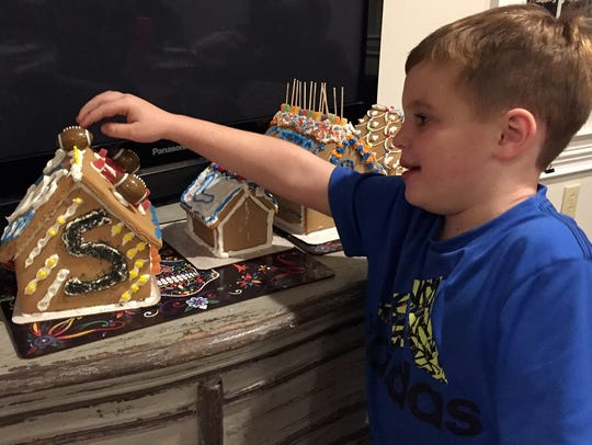 Luke Barrett, 6, decorated his gingerbread house with