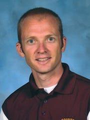 Cooper cross country coach Eric Van Laningham