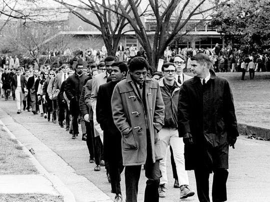 Hundreds of Vanderbilt University students, led by 40 black student members of the Afro-American Club at the school, marched out from campus toward downtown April 5, 1968. They are attending an interfaith memorial service for the Rev. Martin Luther King Jr. at the St. Mary's Catholic Church.