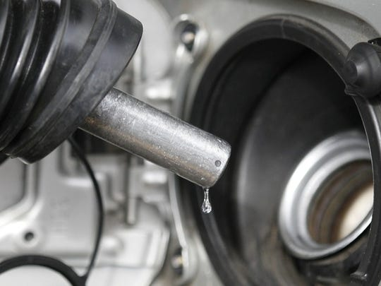 Gasoline drips from a nozzle at gas station Thursday, Feb. 23, 2012, in Lake Oswego.