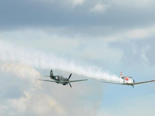 Tora, Tora, Tora once gain recreated the Pearl Habor attack during Saturday's air show at EAA AirVenture 2013 in Oshkosh, Wis., on August 3, 2013.