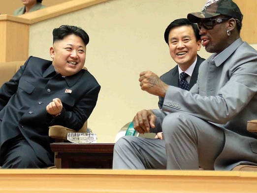 North Korean leader Kim Jong Un, left, speaks with former NBA basketball star Dennis Rodman during a game between U.S. and North Korean players on Jan. 8 at the Pyongyang Indoor Stadium.