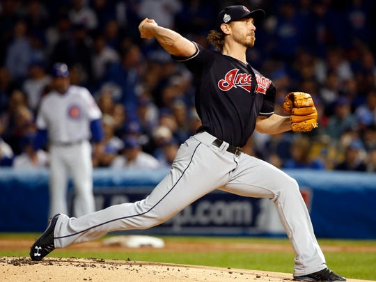 Cleveland Indians starting pitcher Josh Tomlin (43) throws during the first inning of Game 3 of the Major League Baseball World Series against the Chicago Cubs, Friday, Oct. 28, 2016, in Chicago.