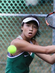 Kinnelon's Brittany Lau hits a return to Mendham's Lindsey Hernandez during a Morris County Tournament first singles semifinal at County College of Morris.