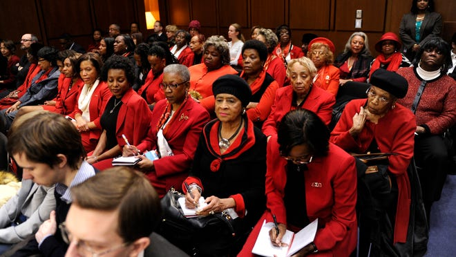 1/28/15 12:05:32 PM -- Washington, DC, U.S.A  -- The ladies in red at the confirmation hearing for Attorney General nominee Loretta Lynch are her sorority sisters from Delta Sigma Theta.  Photo by H. Darr Beiser, USA TODAY Staff ORG XMIT:  HB 132475 AG NOMINATION LY 1/28 [Via MerlinFTP Drop]