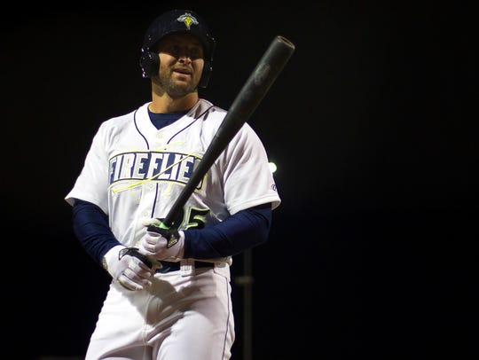 Columbia Fireflies outfielder Tim Tebow (15) reacts