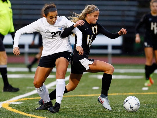 Parsippany Hills midfielder Gabby Gilgorri and Hanover Park junior Claire Cahill battle for the ball during the NJSIAA North 2 Group II girls soccer final.