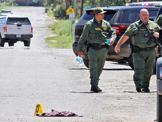 Border Patrol officers secure the perimeter around