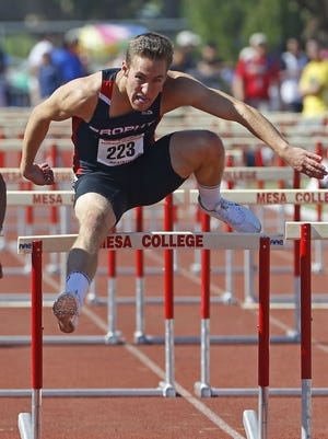 Bobby Grant of Brophy competes in the Division I  110-meter hurdles during the state track and field championships.