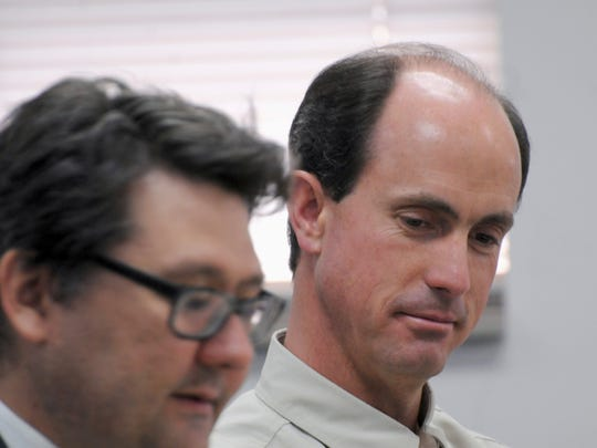 In this July 9, 2015 file photo, Seth Jeffs, right, participates in a state water board meeting in Pierre, S.D. Seth Jeffs is the leader of the South Dakota congregation of the Fundamentalist Church of Jesus Christ of Latter Day Saints, and is one of nearly a dozen members of the polygamous faith arrested on charges of food-stamp fraud and money laundering.