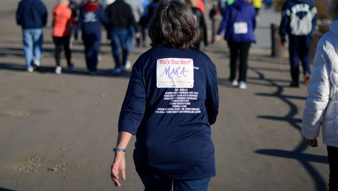 A runner shows support for Mara McCalmon, formerly Skinner,  by wearing her name on her bib Sunday, Nov. 15, during the You're My Hero 5K run at Vantage Point.