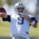 Dallas Cowboys quarterback Tony Romo (9) throws a pass at training camp at River Ridge Fields.