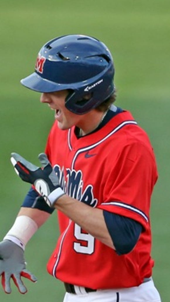 Freshman Kyle Watson celebrates a double in Ole Miss' 9-4 win against William & Mary on Friday.