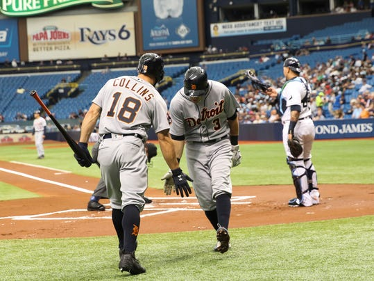 Detroit Tigers center fielder Tyler Collins (18) high fives second baseman Ian Kinsler (3) after his solo home run in the first inning of the game between the Tigers and Tampa Bay Rays at Tropicana Field in St. Petersburg, Fla., on Thursday, April 20, 2017. (Will Vragovic/The Tampa Bay Times via AP)