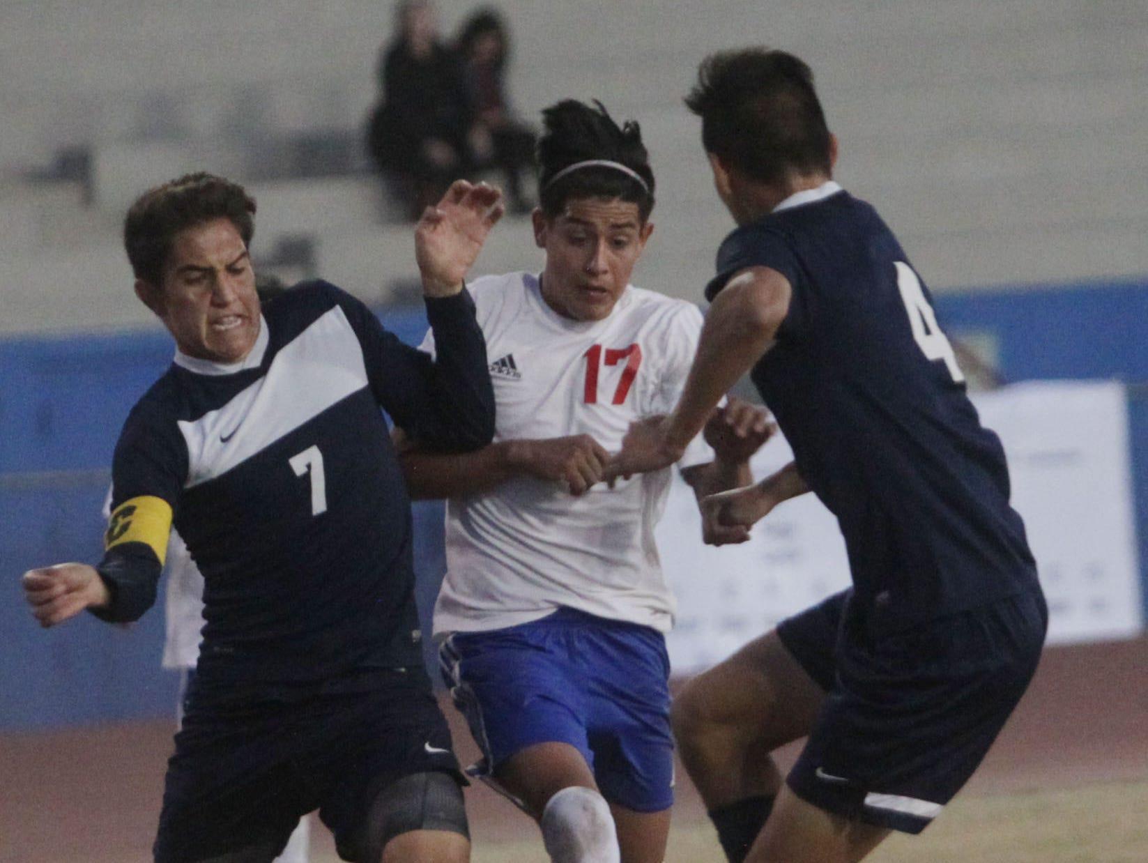 Jonathan Tremper, of Indio High School, tries to break the La Quinta High School defense.