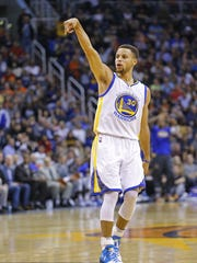 Golden State Warriors guard Stephen Curry (30) celebrates