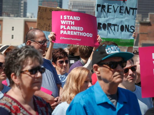 Supporters of Planned Parenthood gathered for a rally on Friday, May 4, 2018, at the Iowa Capitol grounds in Des Moines.