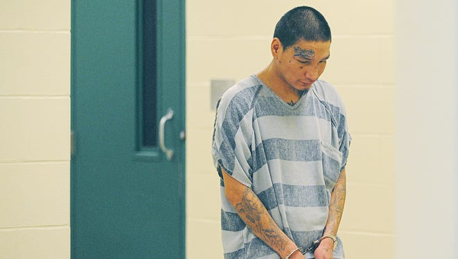 Jonathan Jerome Packard is escorted Friday into the Minnehaha County Courthouse.