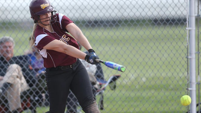 Farmington Hills Mercy's Abby Krzywiecki bats against host Warren Regina on Wednesday. Krzywiecki hit her school-record 41st career home run and got her 46th career win in the second game of an 11-4, 6-4 sweep.
