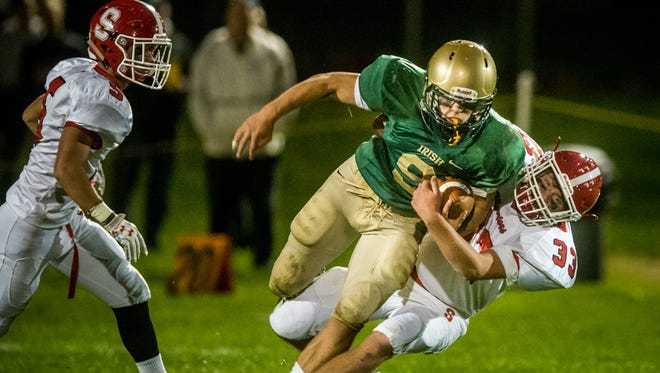 In this file photo, York Catholic's Kyle Dormer fights for extra yards in a game against Susquehannock earlier this year.
